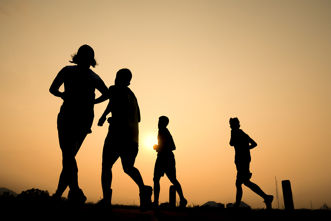 Silhouette group of young healthy lifestyle running at sunrise.