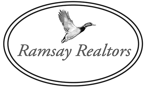 Ramsay Realtors' logo. They are a T-shirt logo sponsor for the 13th Annual Sounds of Silence Run/Walk. Please click on their link to visit them.